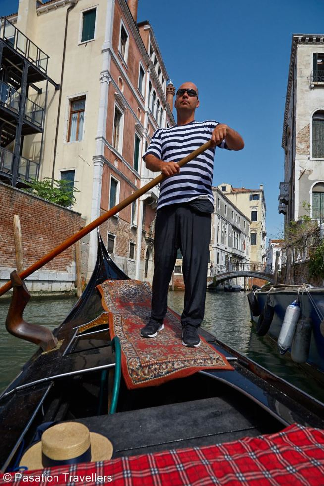 venice-gondolier-proudly-steering-from-the-right-side