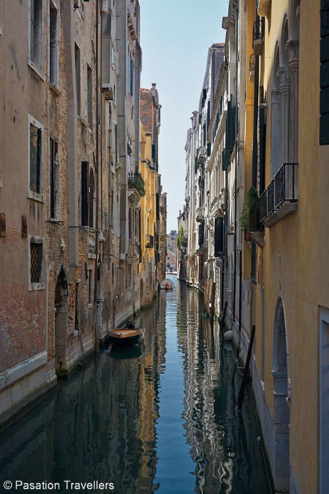 venice-peacefully-entering-narrow-canals-on-gondola